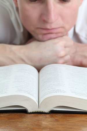 Man studying the Bible  Focus on the Bible photo