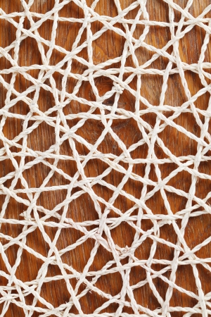 straw mat: Abstractedly looking straw mat on wooden background