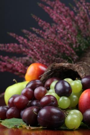 Cornucopia, symbol of food and abundance, with various fruits photo