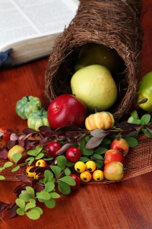 Thanksgiving arrangement with cornucopia and the Bible in background