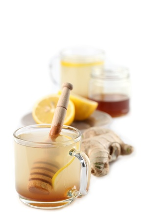 Ginger tea with honey and lemon isolated on white background photo