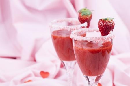 Fresh strawberry drink in wine glasses  Shallow dof photo