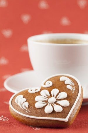 decaffeinated: Gingerbread heart and a cup of coffee  Shallow dof Stock Photo