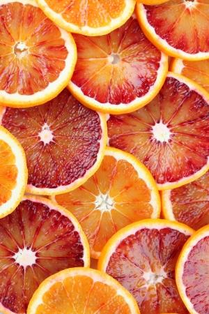 Beautiful background made of blood orange slices Standard-Bild