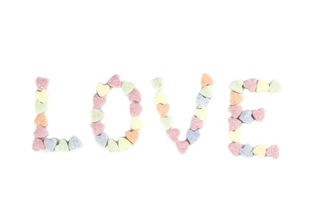 Word Love made of little colorful candy hearts isolated on white background Stock Photo - 17695604