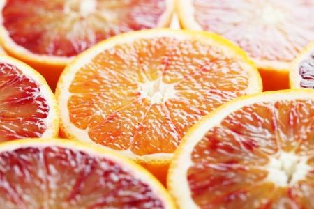 halved: Close up of halved blood orange  Shallow dof Stock Photo