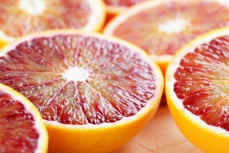 half cut: Close up of halved blood orange  Shallow dof Stock Photo
