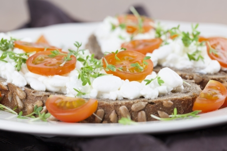 wholemeal: Healthy sandwiches with cottage cheese, cress and cherry tomatoes Stock Photo