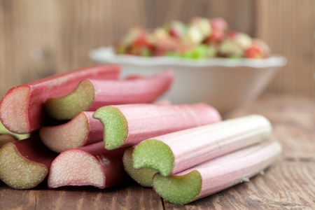 rhubarb: Fresh rhubarb on wooden background  Shallow dof