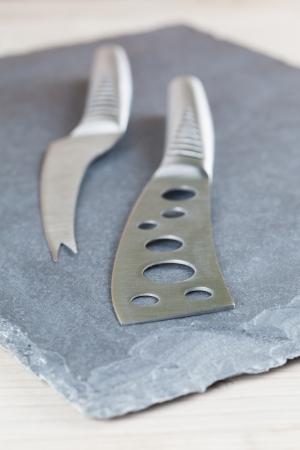 slateboard: Two classy cheese knives on a slate board