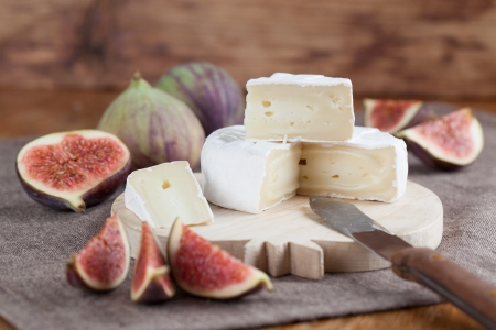 wedge: Camembert and fresh figs on a cutting board Stock Photo