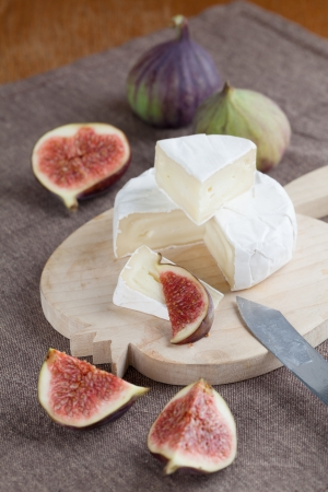 Camembert and fresh figs on a cutting board photo