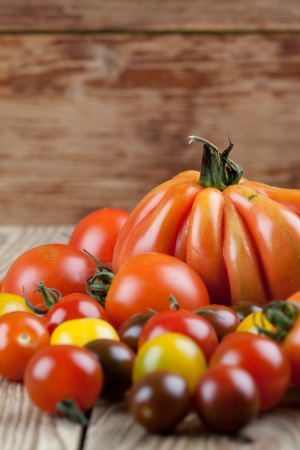 heirloom: Yellow, red and black tomatoes on wooden table Stock Photo