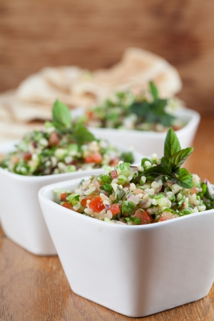 Gourmet Middle Eastern salad Tabbouleh in white bowls photo