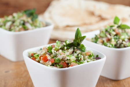 Gourmet Middle Eastern salad Tabbouleh in white bowls Stock Photo