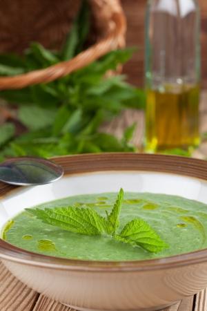 nettle: Nettle cream soup on wooden Shallow dof