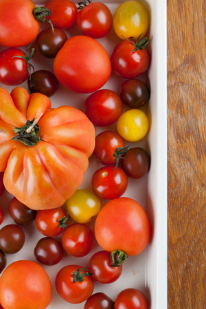 heirloom: Yellow, red and black tomatoes on baking sheet