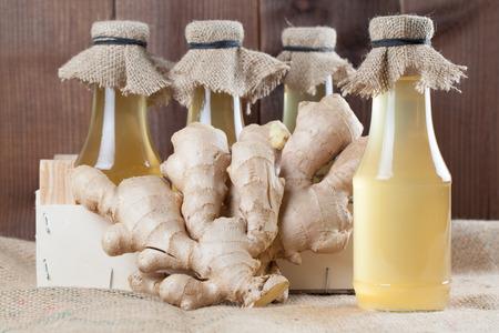 Bottles with homemade ginger syrup. Shallow dof Standard-Bild