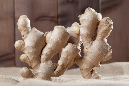 close up food: Close-up of standing ginger roots. Shallow dof