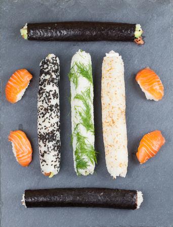 slate board: Homemade sushi rolls on a slate board