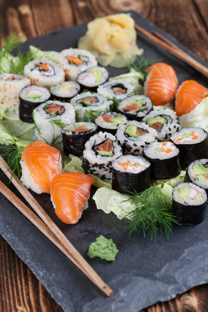 slate board: Sushi set on a slate board. Maki, uramaki and nigiri sushi. Stock Photo