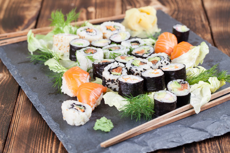 Sushi set on a slate board. Maki, uramaki and nigiri sushi. Stock Photo