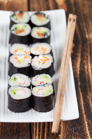 Maki sushi set on a white plate. Shallow dof