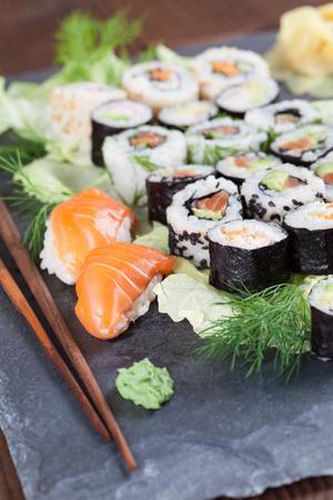 Sushi set on a slate board. Maki, uramaki and nigiri sushi. Stock Photo