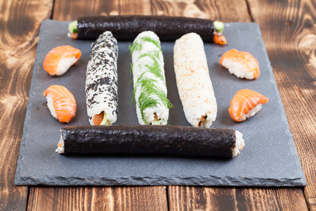 Homemade sushi rolls on a slate board