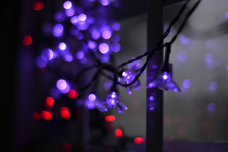 Purple and red Lights near to a window at night
