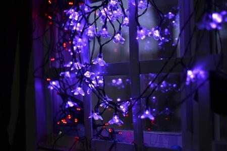 Purple Lights near to a window at night