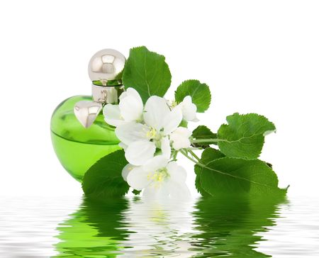 Perfume bottles and apple flowers on a white background