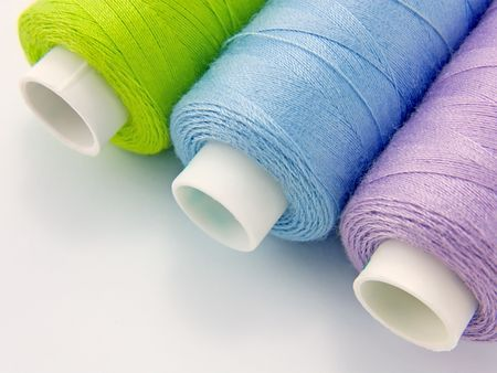 Thread for sewing on a white close-up Stock Photo
