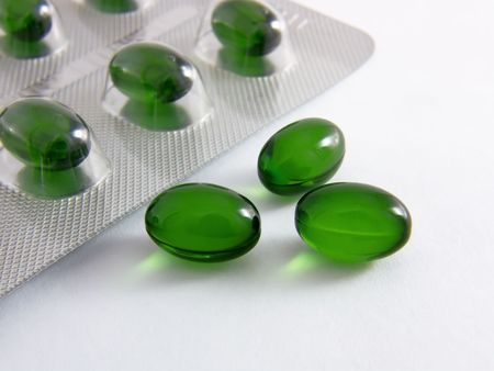 Health capsules with oil  close-up
