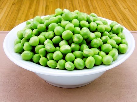 Plate of fresh green peas close-up Stock Photo