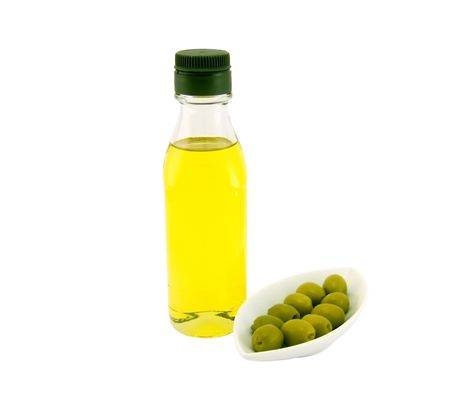 Bottle of olive oil and olives on a white