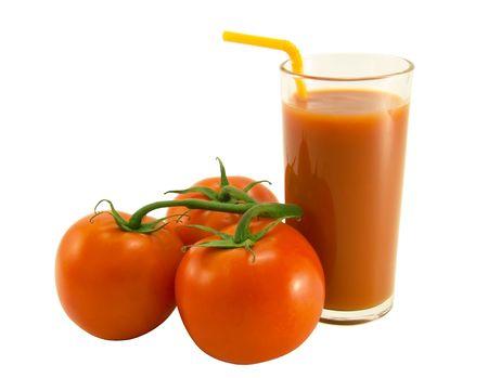 Tomato juice and three tomato close-up