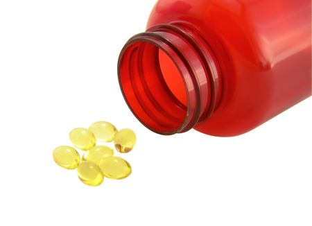 Health capsules with oil for the valuable feed of sportsmen and people,  for healthy way of life on a white