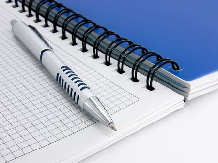 Open a notebook and pen for notes close-up