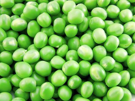 Fresh green peas as background