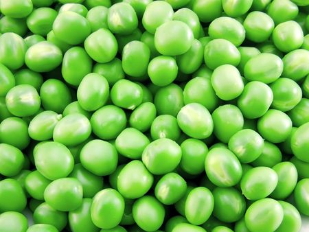 Fresh green peas as background