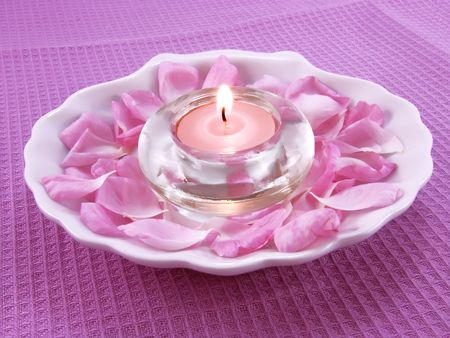 Aroma candle and petals of rose for relax