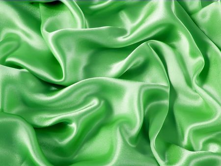 Smooth elegant green satin silk fabric as background photo