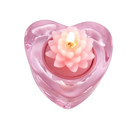 Aroma candle lotus flower in a glass candlestick in the form of hearts, close-up on a white background Stock Photo - 6863964