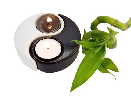 fengshui: Candlestick yin-yang, candles and a branch of bamboo on a white background close-up Stock Photo
