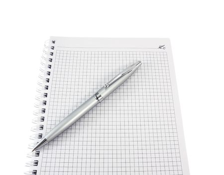 Open a notebook and pen for notes close-up on a white background photo
