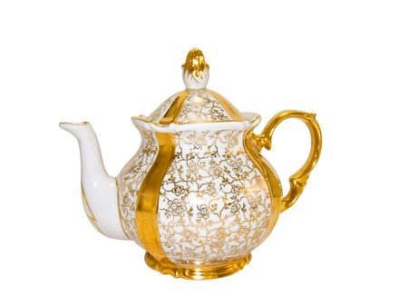 Gold porcelain teapot from an old antique service on a white background close-up