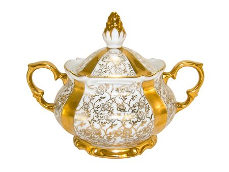 Gold porcelain sugar bowl from an old antique tea-set on a white background close-up