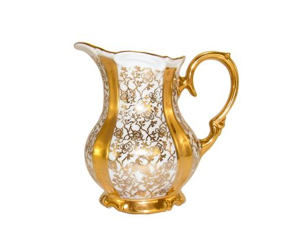Gold porcelain milkjug from an old antique service on a white background close-up