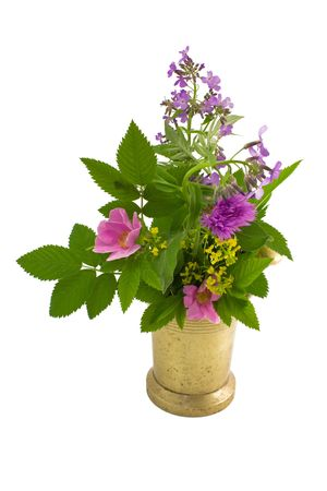 Old mortar and bouquet of herb on a white close-up photo